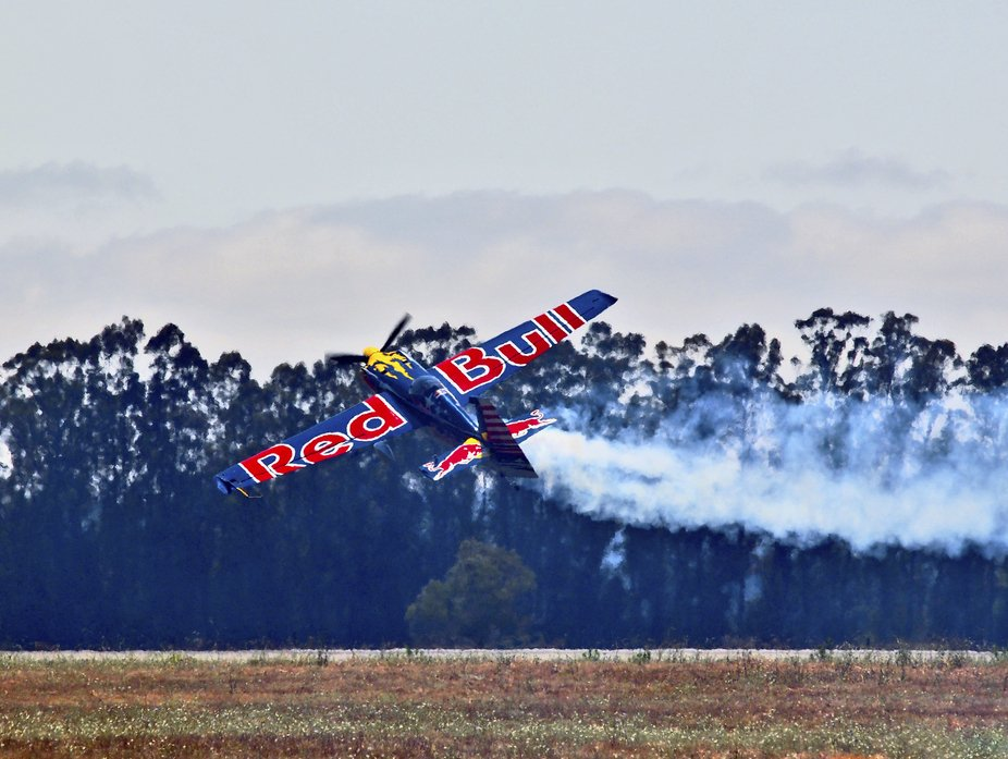 I gathered this image of Kirby Chambliss flying the Red Bull aircraft Corvus Racer 540 low across...