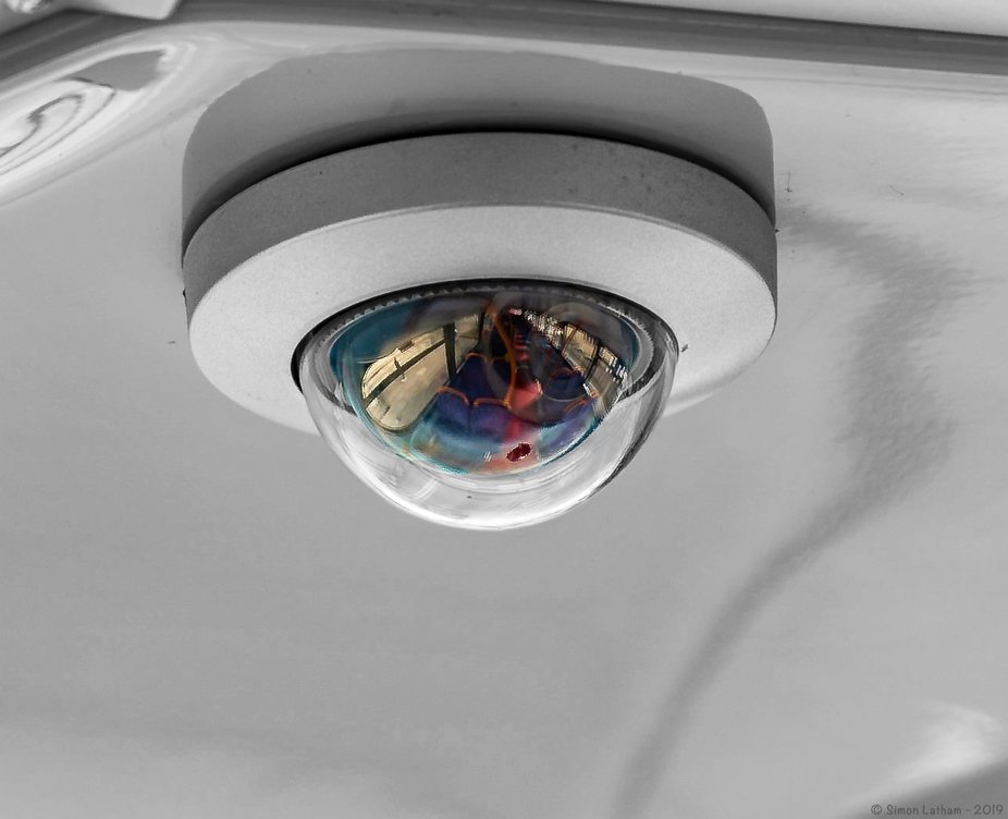 Surveillance camera on the upper deck of one of our local buses. The 'lens' is left in color ...