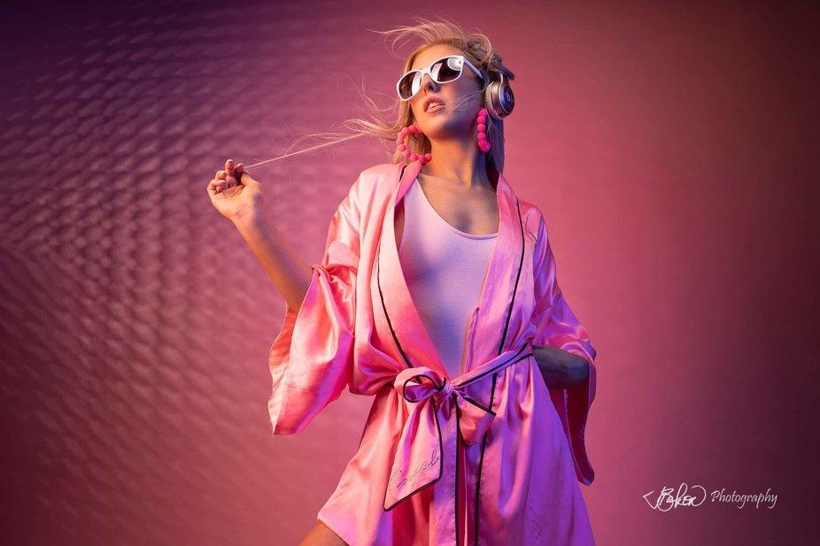 Pink themed model showcasing music.