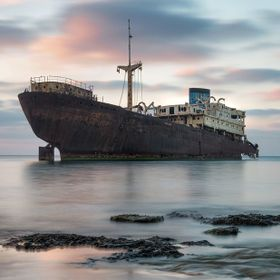 A shipwreck of 1981 resting near  Arrecife harbour in Lanzarote in the Canaries awaits its eventual  fate .