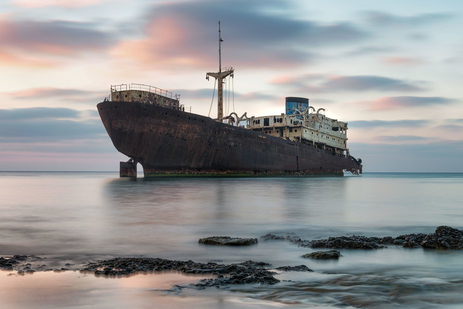 A shipwreck of 1981 resting near  Arrecife harbour in Lanzarote in the Canaries awaits its eventu...