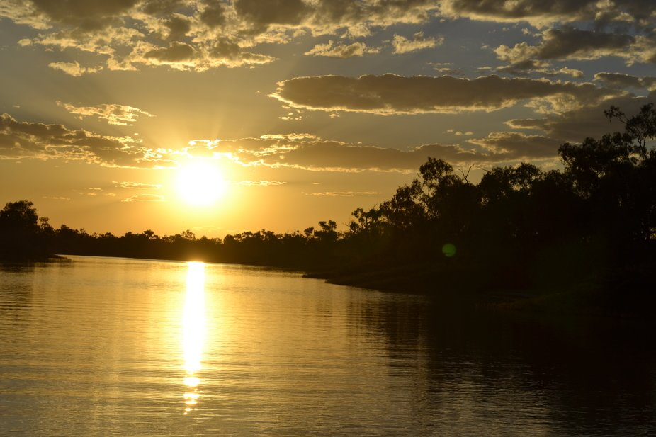 Sunset aboard the paddle steamer on the Thomson River, Longreach Qld