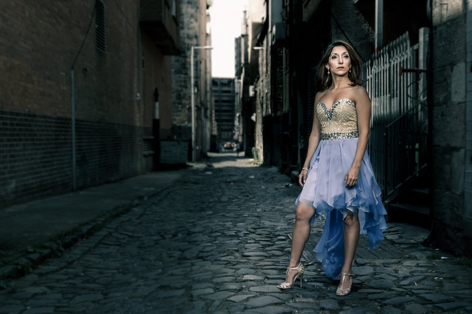 Christina Bianco promo shot in an alleyway in Glasgow, Scotland