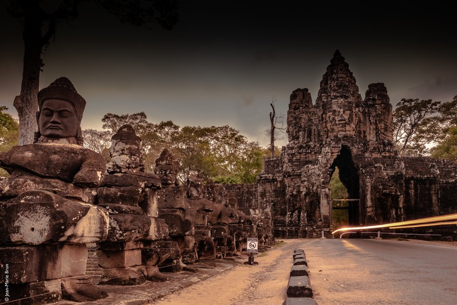 An evening of March, night is falling while a motrobike goes through Angkor Thom gate.