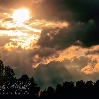 This sunset was so beautiful with the sun's rays beaming through the clouds.  It was like getting a glimpse of heaven from here!