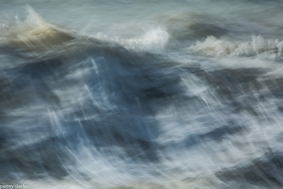 I decided to experiment with capturing the mood and energy of large breakers crashing ashore.