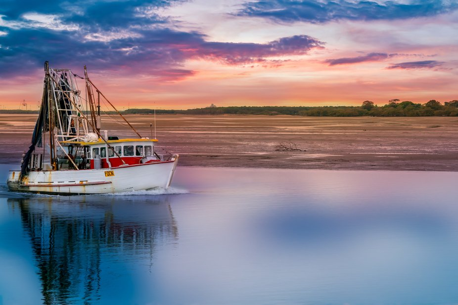 Trawler returning to Cabbage Tree Creek after a days catch, Shorncliffe Queensland Australia.
