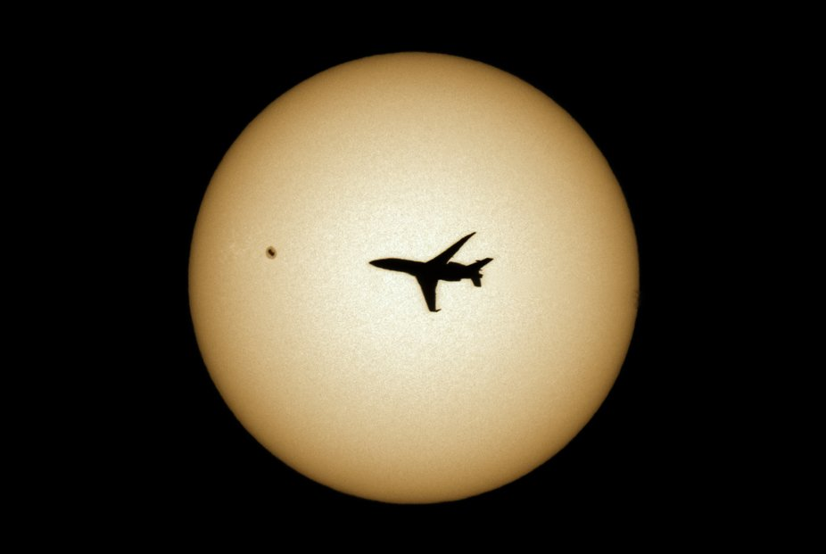 While shooting the latest sunspot on April 10, 2019, I caught an airplane going by. William Optic...