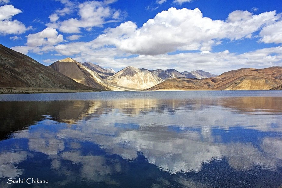 The morning at Pangong lake is always magical. The sun lights up the Himalayas and reflects the c...