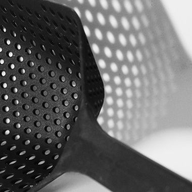 Black and white sieve with shadow, flash light off camera