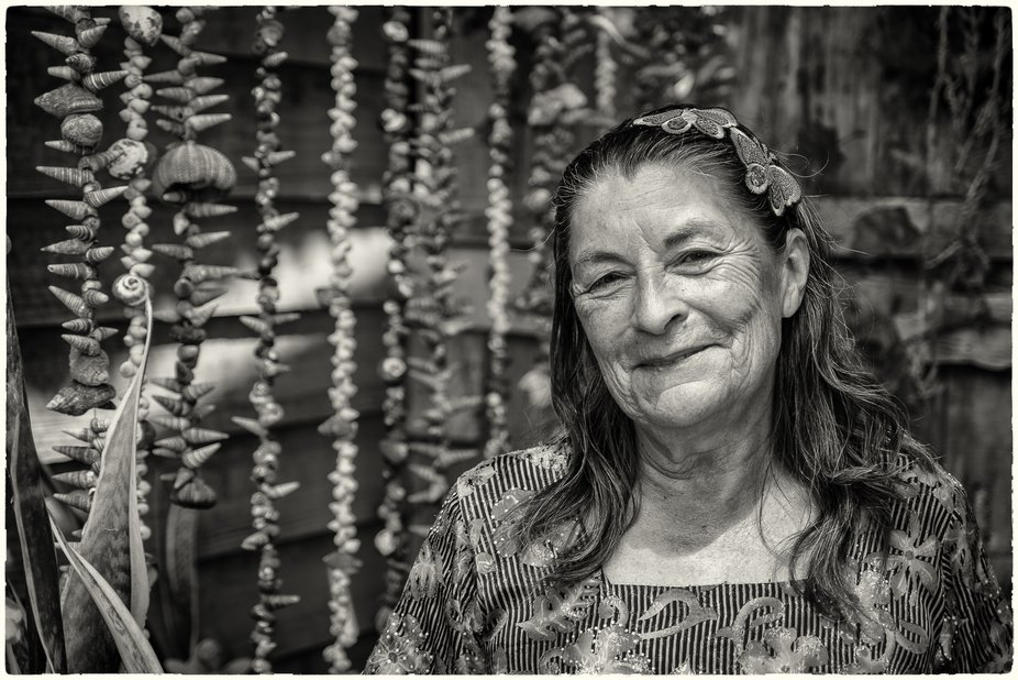 Beautiful person, so proud for her garden at the shore of the ocean in Atacama desert.
