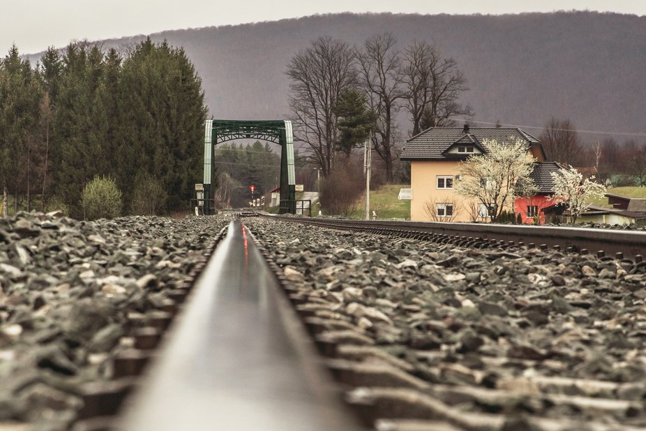 Railroad landscape to town on a rainy winter day
