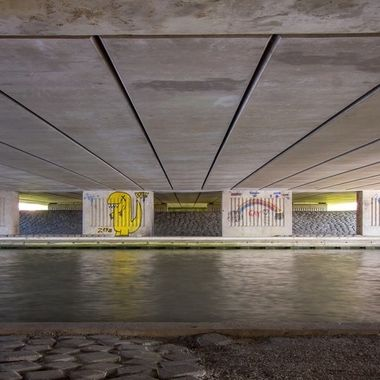 Underneath a viaduct with graffiti covered pillars, Purmerend, Holland