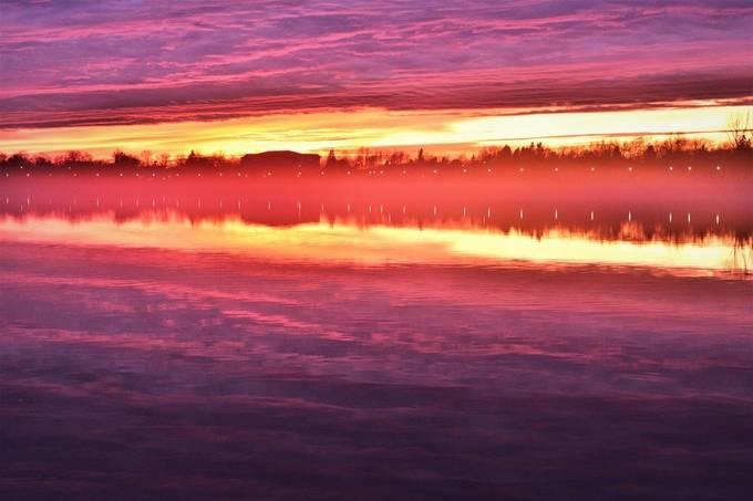 Fog rising off the upper Rainy River at sunset tonight