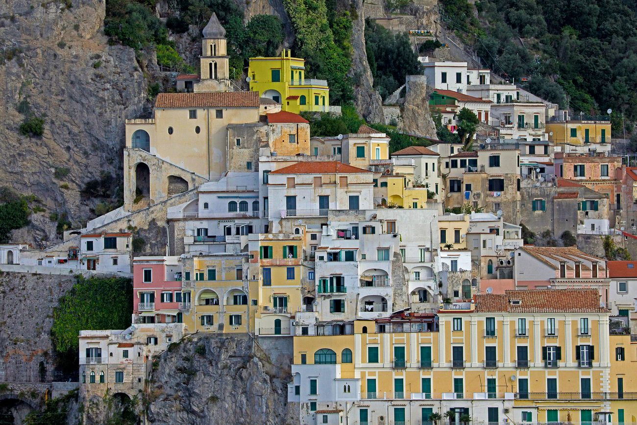 Colorful buildings of  Amalfi cascading down a mountainside.