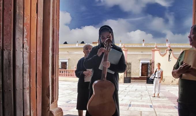 Guitar playing Nun