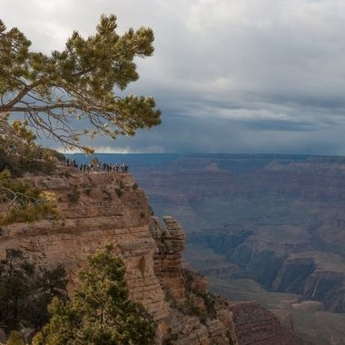 Though the canyon is in shadow, you can still feel the immensity of it especially if you include tourists on a distant viewpoint.