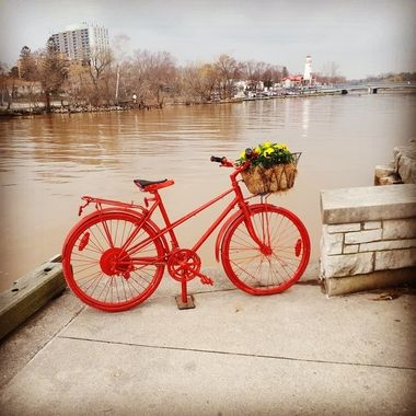 The Red Bicycle stands outside Snug Harbour which bills itself as a 'Seafood specialist overlooking the water, with a relaxed, modern interior & outdoor patio seating.'