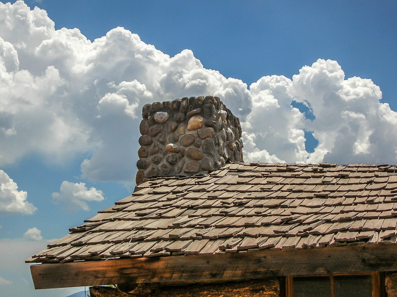 Log cabin roof and clouds
