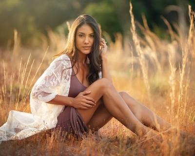 Gabrielle Sitting in a Field
