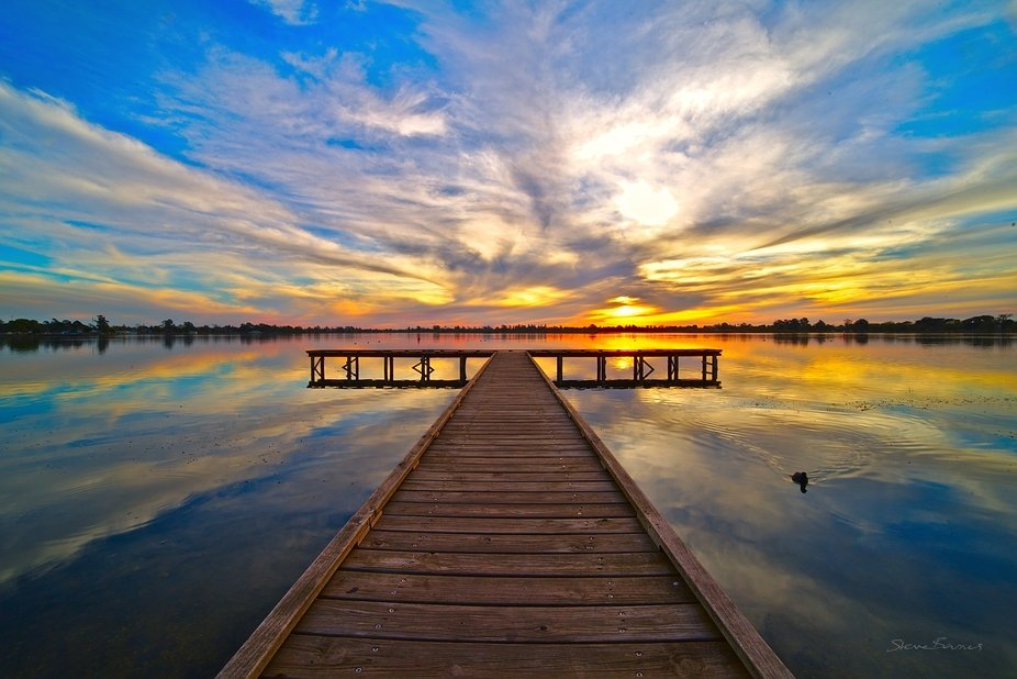 "#1 of ""The Hand Of God"": four amazing sunsets on one night at Lake Wendouree, Ballarat, Australia The most amazing textures appeared early in the sunset, with colours radiating throughout"