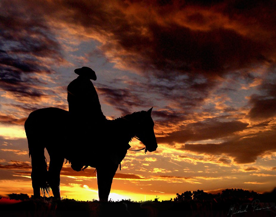 Cowboy and a Horse  with awesome sunset