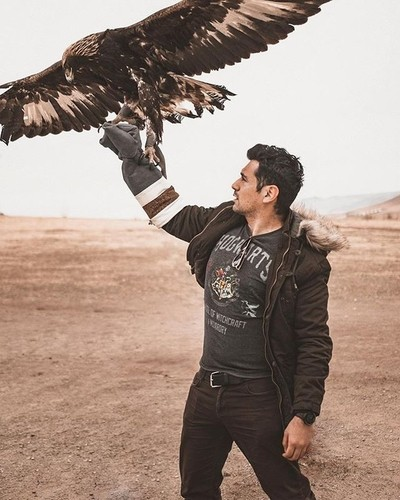 Just out here in Mongolia training some eagles to be my minions . . . #mongolia #eagles #portraitphotography #canon #portrait_mood #portrait_vision #travel #travelphotography #welivetoexplore #exploretocreate #nomads #travelersnotebook #postthepeople #vis