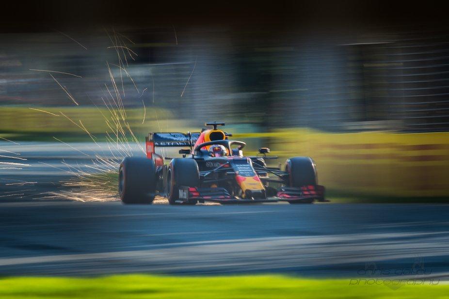 A shower of sparks from Max Verstappens Red Bull F1 car as he brakes for turn 6 at Albert Park du...