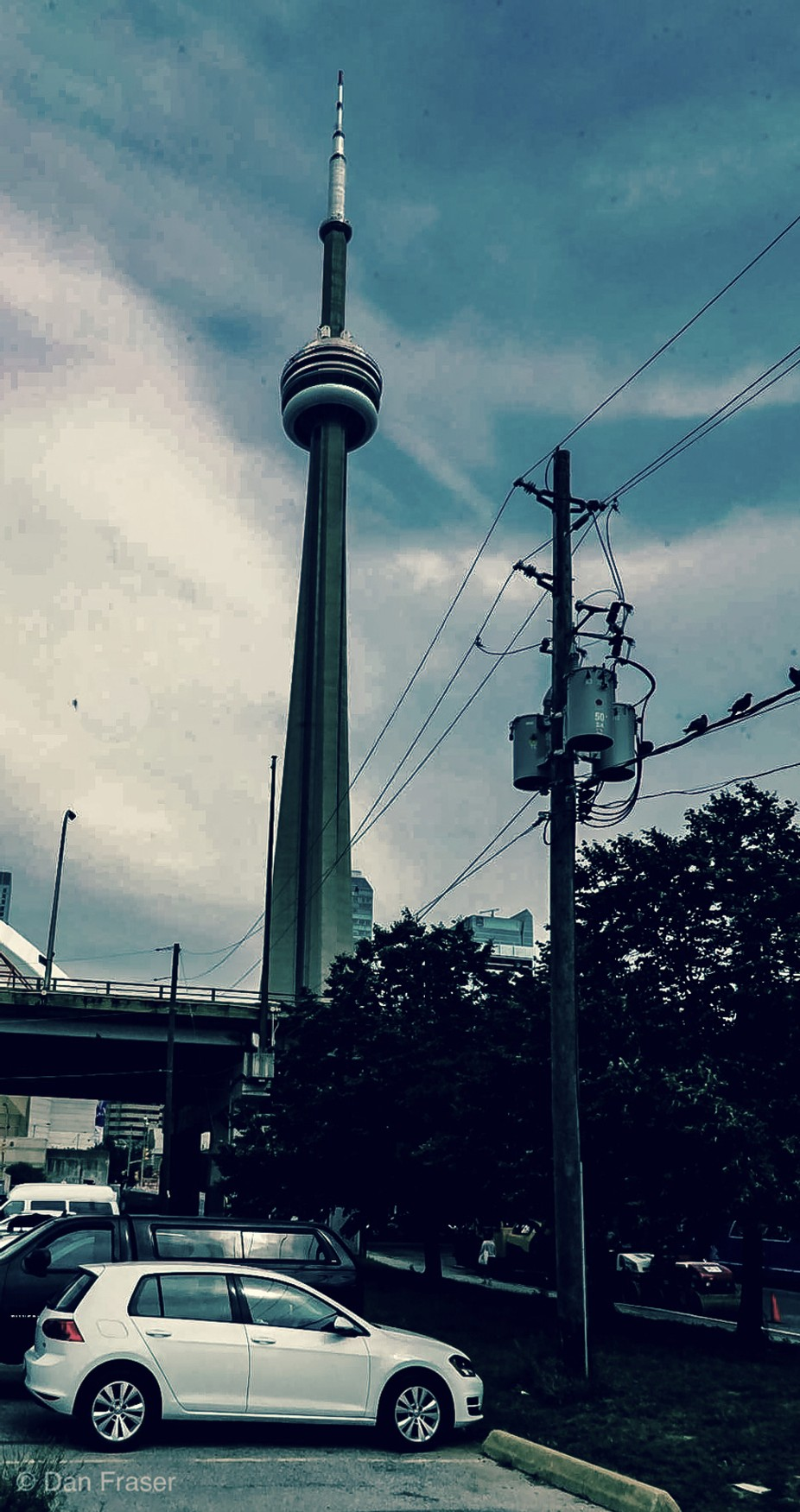 The CN Tower held the record for the world's tallest free-standing structure for 32 years until 2007 when it was surpassed by the Burj Khalifa and was the world's tallest tower until 2009 when it was surpassed by the Canton Tower.[9][10][11][12] It is now the ninth tallest free-standing structure in the world and remains the tallest free-standing structure in the Western Hemisphere. In 1995, the CN Tower was declared one of the modern Seven Wonders of the World by the American Society of Civil Engineers. It also belongs to the World Federation of Great Towers.[13][14][7]  It is a signature icon of Toronto's skyline[15][16] and attracts more than two million international visitors annually.[7][17]