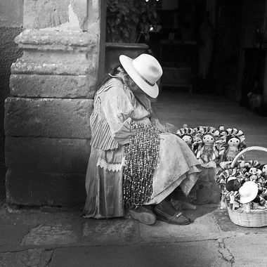 Vendors in San Miguel De Allende are walking miles every day, quick rests like this are something that you can see often.