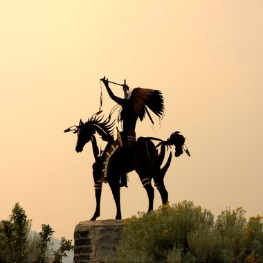 Statue at the entrance of the Nk'mip Desert and Heritage centre in British Columbia.  They sky is like this as there were multiple forest fires surrounding the area.  There's also a winery here, amazing wine!