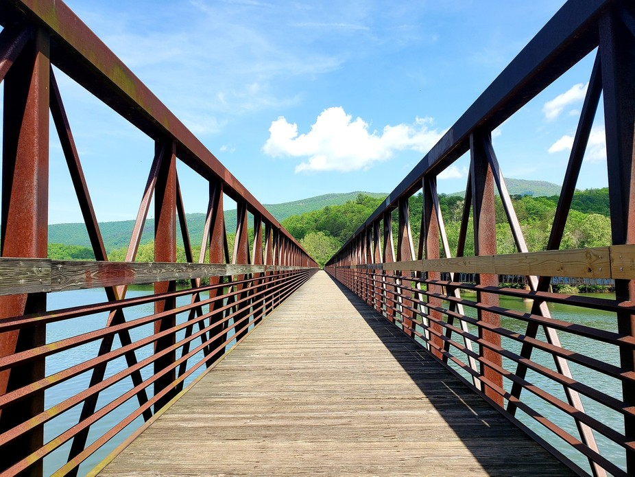Took a walk on the Appalachian trail and came across this long footbridge after coming down the m...