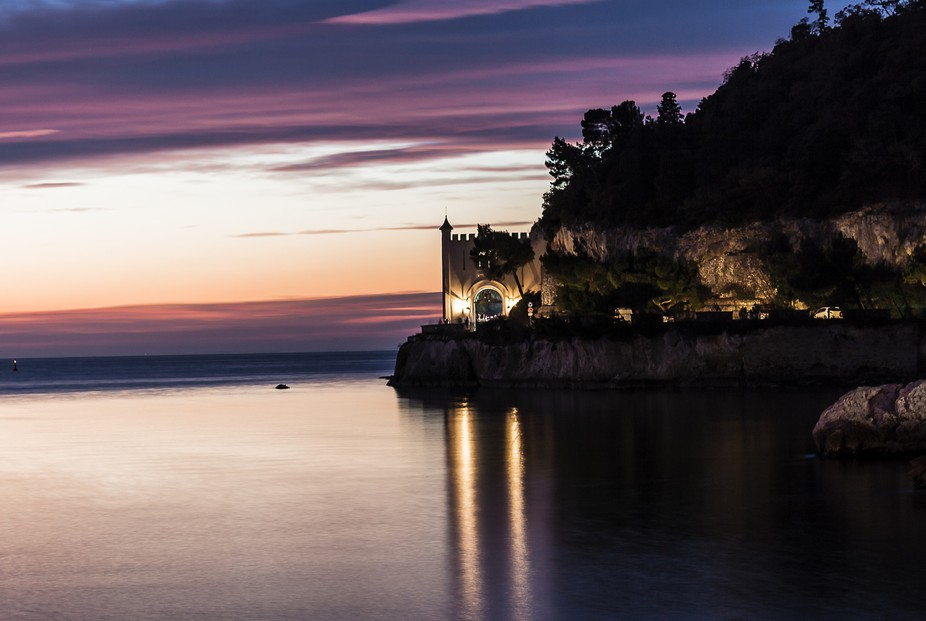 Miramare castle's entrance in Trieste's gulf in the blu hour of the last day of...
