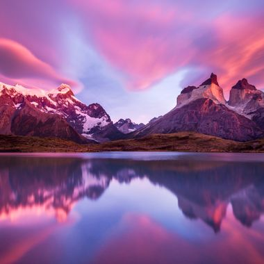 This is one of my favorite images from my second sunrise at Torres del Paine national park. During the first day i looked for some locations to shoot sunrise and luckly found this spot. I thought it was good but it was a little bit far away, and getting to it during the night might not be that easy... However, i decided to go for it and before 5 am i was already walking to the spot. When looking at the night sky, things didn't seem promising as almost no star was visible. I arrived at the location at 6:50am, and when i was almost hopeless about having a pink sunrise a pinkish reflection coming from above the horns started to shine my day. I had time to frame the shot and try different stuff, even with a very long shutter speed. This is for me the most important rule for sunrise photography... even is you already selected the spot, GO EARLY! Light changes and new compositions may come to your mind, but the perfect light won't be there for a long time, so normally it is important to frame before the best light.  This time, i had the chance to do that... i arrived more than 1 hour before sunrise and did everything as it is supossed to be done. Luckily, this time nature rewarded me enormously!