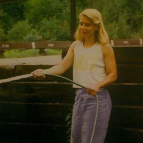 This is a picture of a picture of my mom in the late 80's in Elliot Lake Ontario. Using old rail way wood was popular in this city for retai...