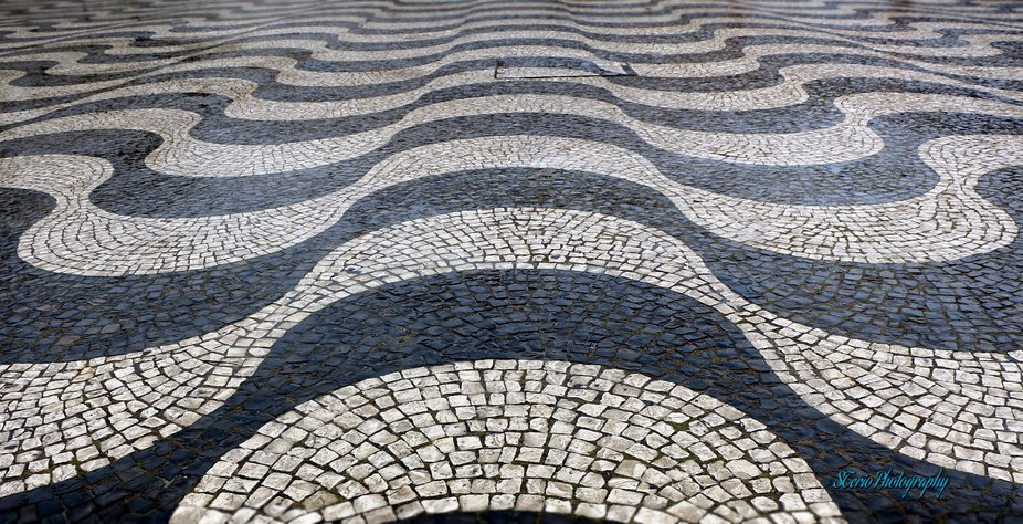 Portuguese Pavement - A dying art. Usually used in sidewalks, it is in squares and atriums that t...