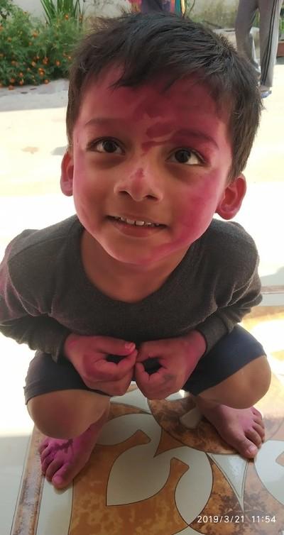 """A little boy in joy of """"HOLI"""" festival"""