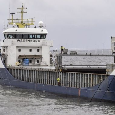 The Crew of the M/V Ostborg covering the hold with decking covers ready to set sail.
