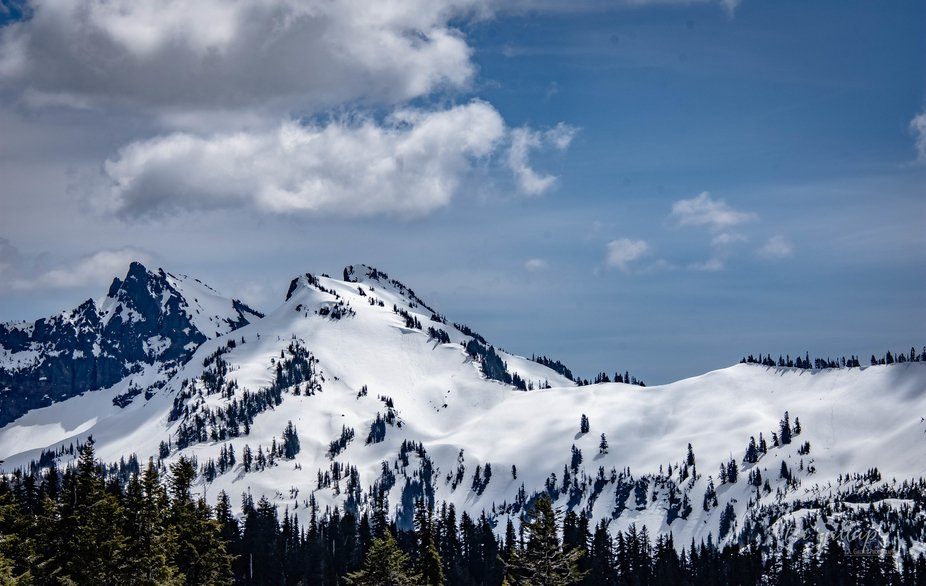 The satiny look of mountains blanketed in snow.