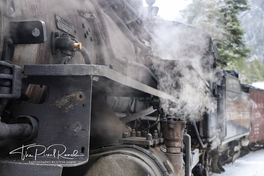 A cold day on the Durango & SIlverton Narrow Gauge Railroad. Engine #476 steams during a ...