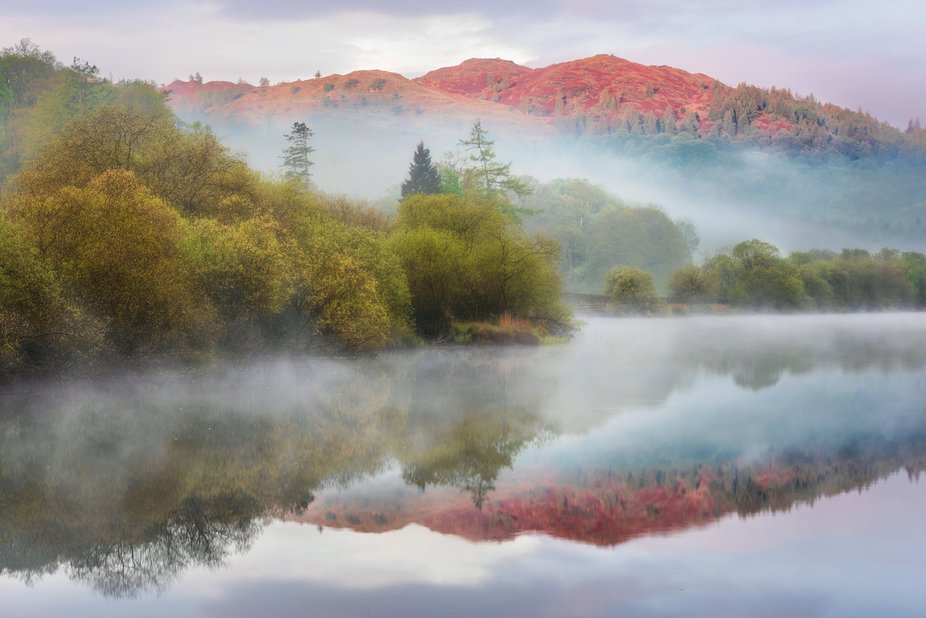 Park fell is briefly illuminated by the first light breaking through the morning mist    Visit my...
