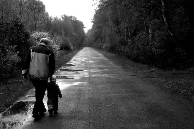 Grandfather and grandson on their way