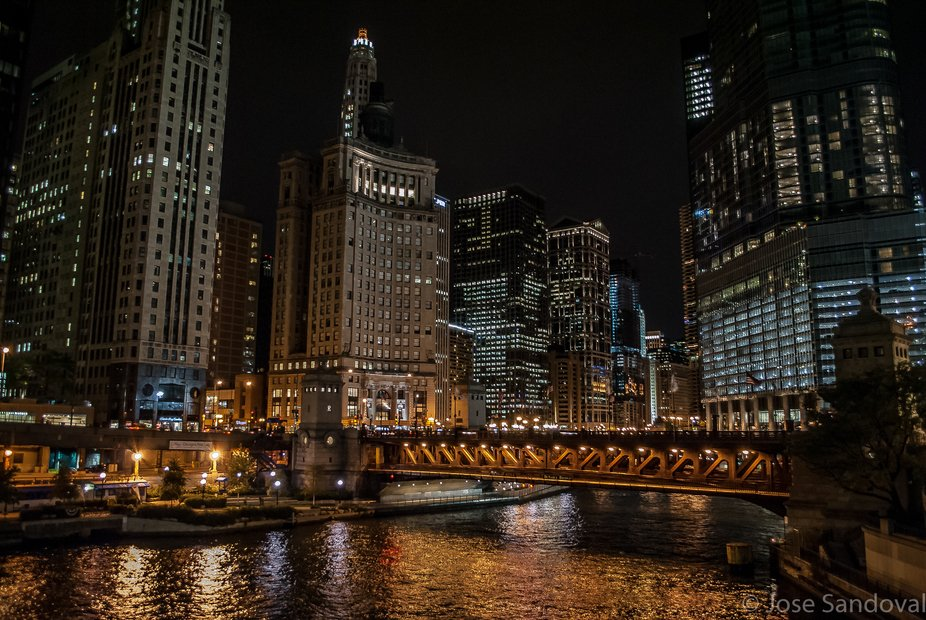The reflections of the lights on the river.  Making this moment all possible and to enjoy. There ...