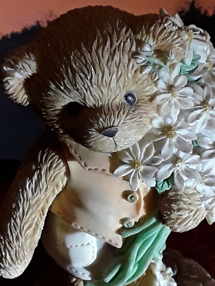 Delightful little teddy carrying a bunch of flowers. Detail helped enhanced the bears features. T...