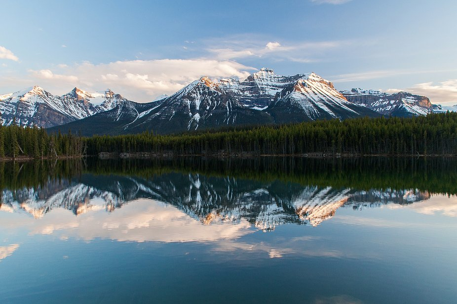 Wonderful reflections on water of Herbert Lake in Banff NAtional PArk, Alberta, Canada, along the...