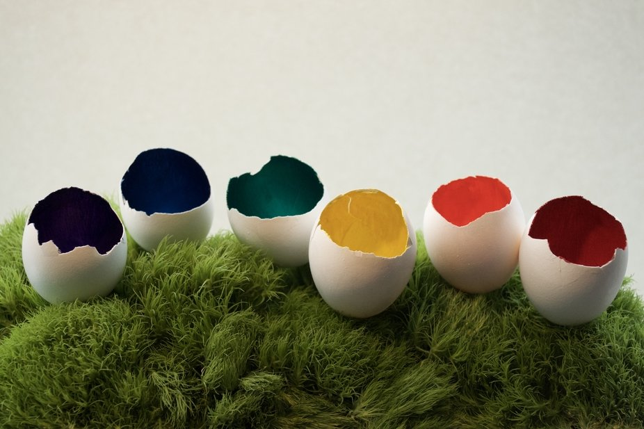 Painted hollow egg shells in bright colours.