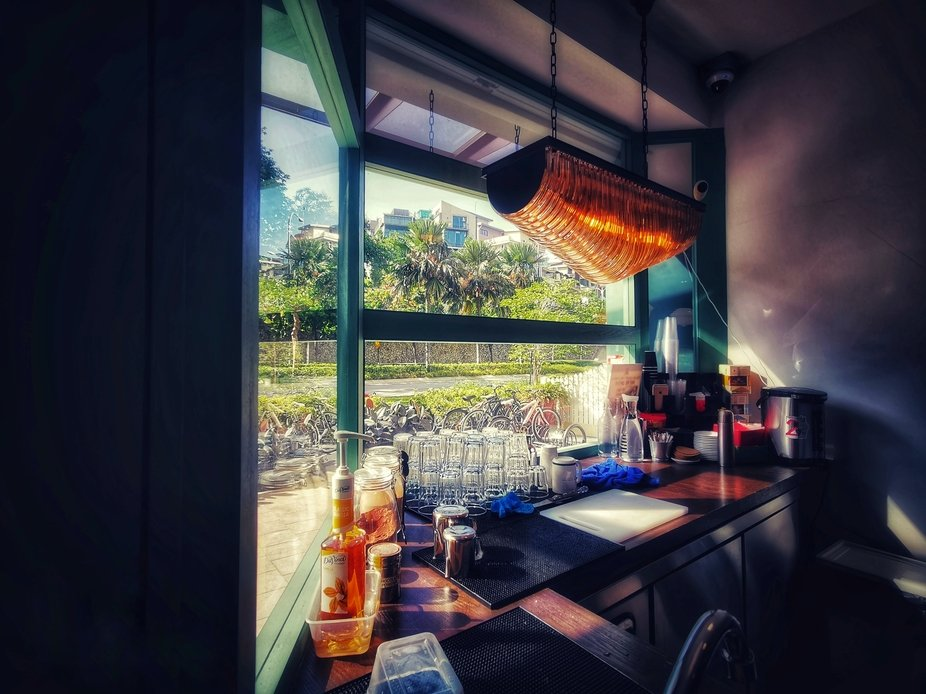 Taken in a cafe with it's kitchen facing the entrance with a wonderful view of greens an...