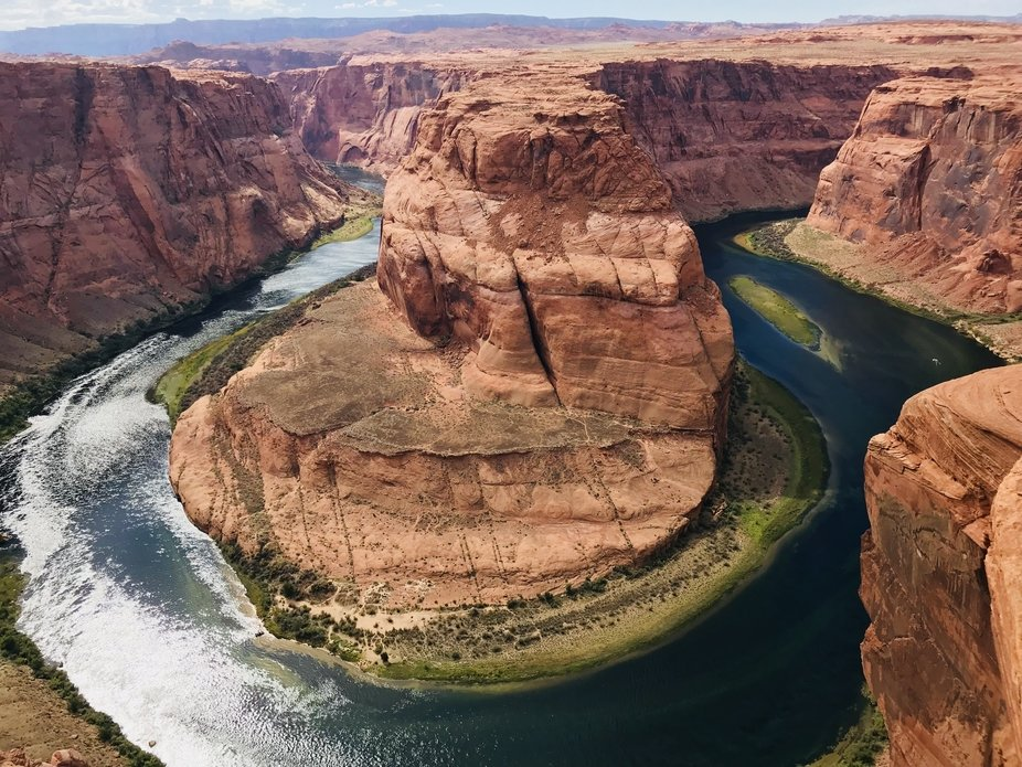 The Colorado River curves gracefully around horshoe Bend in Page, AZ.
