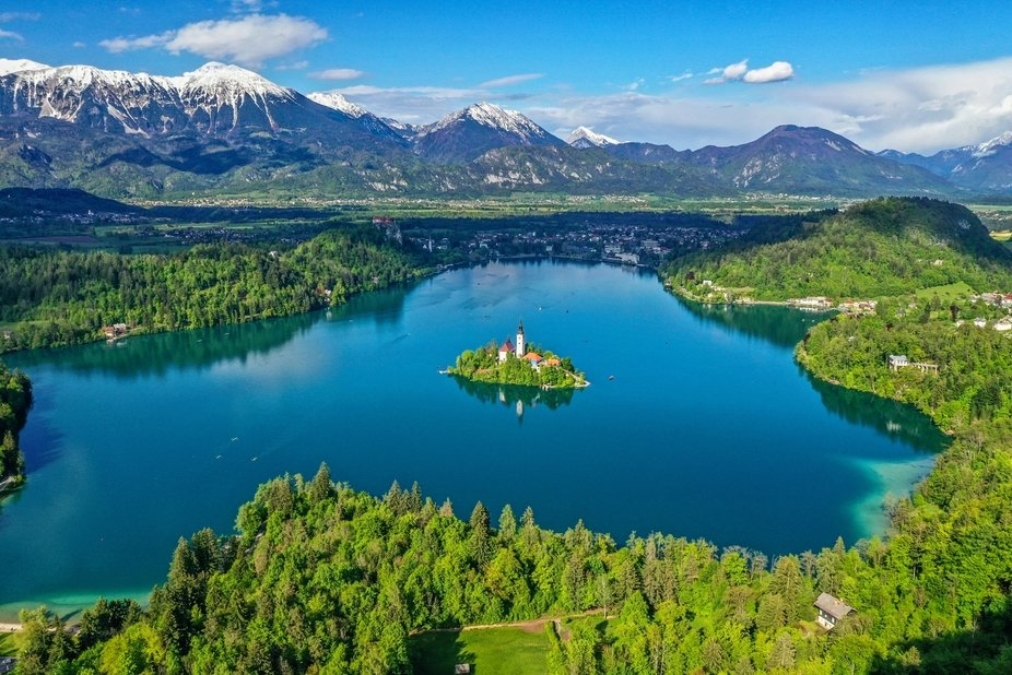 At the foot of the Julian Alps lies the emerald-colored Lake Bled. In the middle of the lake is t...