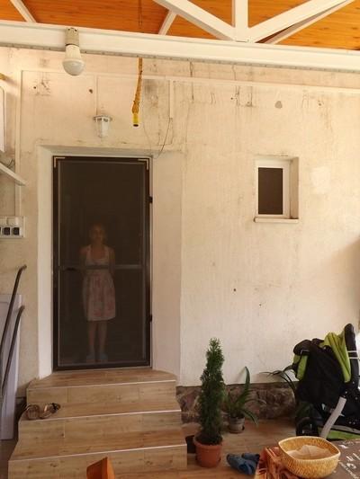 Girl behind the door ...